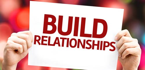 build relationships sign